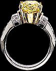 Oval fancy yellow diamond and  round diamond ring